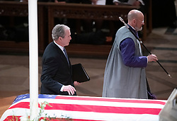 Former United States President George W. Bush walks past the casket to deliver the eulogy at the National funeral service in honor of the late former United States President George H.W. Bush at the Washington National Cathedral in Washington, DC on Wednesday, December 5, 2018.<br /> Photo by Ron Sachs / CNP/ABACAPRESS.COM