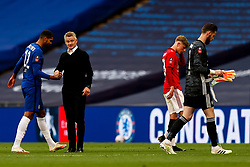 Manchester United manager Ole Gunnar Solskjaer looks over to Brandon Williams and David De Gea of Manchester United whilst shaking hands with Ruben Loftus-Cheek of Chelsea - Mandatory by-line: Rogan/JMP - 19/07/2020 - FOOTBALL - Wembley - London, England - Manchester United v Chelsea - Emirates FA Cup