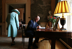 The Duke of Edinburgh signs the visitors book at Hillsborough Castle, Belfast on the third and final day of her visit to Northern Ireland.