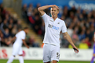Jay Fulton of Swansea city reacts in frustration after missing a chance to score. EFL Cup. 3rd round match, Swansea city v Manchester city at the Liberty Stadium in Swansea, South Wales on Wednesday 21st September 2016.<br /> pic by  Andrew Orchard, Andrew Orchard sports photography.
