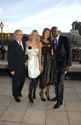 Left to right, Musician NICK RHODES, Model MEREDITH OSTROM and Fashion designer OZWALD BOATENG and his wife GYUNEL at the Fortune Forum Dinner held at Old Billingsgate, 1 Old Billingsgate Walk, 16 Lower Thames Street, London EC3R 6DX<br /><br />NON EXCLUSIVE - WORLD RIGHTS