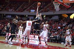 14 January 2017:  Rauno Nurger hooks a shot over Phil Fayne(10) and Deontae Hawkins(23) during an NCAA  MVC (Missouri Valley conference) mens basketball game between the Wichita State Shockers the Illinois State Redbirds in  Redbird Arena, Normal IL