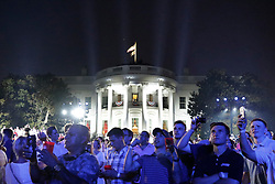 Guests react on the South Lawn of the White House during a fireworks display in Washington, D.C., U.S., on Wednesday, July 4, 2018. Trump's campaign won the technical knockout of a lawsuit filed by two Democratic National Committee donors and a DNC staffer who accused it of colluding with Russian to publish compromising information about the Clinton campaign on WikiLeaks that included details about their lives. Photographer: Yuri Gripas/Bloomberg