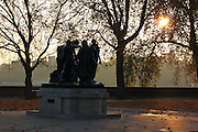 """The wonderful """"Burghers of Calais"""" sculpture by Auguste Rodin, in London's Victoria Tower Gardens, Westminster, just after sunset."""