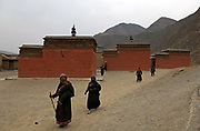 Pilgrims walking the kora for Losar prayers, at Tibet's New Year.<br /> <br /> Each day during Losar thousands of pilgrims walk the kora around the monastery, which is lined with prayer wheels.<br /> <br /> Established in 1709, Labrang housed over 4000 monks at its peak, but now only has around 1500 monks.