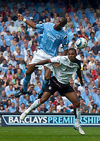 Photo. Glyn Thomas.Digitalsport<br /> Manchester City v Fulham. <br /> Barclays Premiership. 14/08/2004.<br /> Man City's Nicolas Anelka (L) fights an aerial battle for possession with Fulham's Zat Knight.