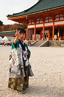 """Little Japanese boy dressed in kimono for """"Shichi-Go-San"""" at Heian Shrine in Kyoto.  Shichi go san is literally 7-5-3 - a traditional rite of passage and festival day in Japan for children the age of seven, five or three held annually on November 15.  As Shichi-Go-San is not a national holiday, it is normally observed on the nearest weekend.  Children are still dressed in kimono, many for the first time, for visits to shrines though western-style formal wear is also worn by some children."""