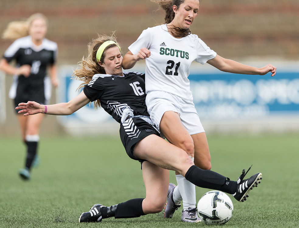 Omaha Skutt's Lizzy O'Bryan, No. 16, and Columbus Scotus' Courtney Kosch, No. 21, fight for the ball. Omaha Skutt played Columbus Scotus in the Class B girls Nebraska state soccer championship at Morrison Stadium on Wednesday, May 17, 2017, in Omaha.<br /> <br /> MATT DIXON/THE WORLD-HERALD