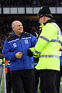 Dagenham & Redbridge Manager John Still chats with a Policeman prior to kick off. The Emirates FA cup, 3rd round match, Everton v Dagenham & Redbridge at Goodison Park in Liverpool on Saturday 9th January 2016.<br /> pic by Chris Stading, Andrew Orchard sports photography.