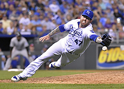 August 22, 2017 - Kansas City, MO, USA - Kansas City Royals relief pitcher Peter Moylan misses a ground out by the Colorado Rockies' DJ LeMahieu before second baseman Whit Merrifield backed up the play and made the throw to end the top of the eighth inning at Kauffman Stadium in Kansas City, Mo., on Tuesday, Aug. 22. 2017. (Credit Image: © John Sleezer/TNS via ZUMA Wire)