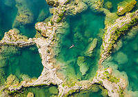 Aerial view of woman in swimsuit bathing in the El Salto waterfalls, Mexico.