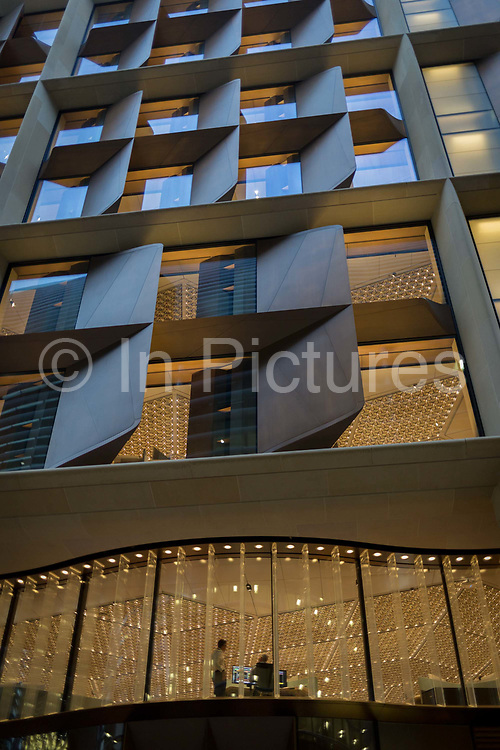 Employees with Bloomberg work beneath bold, modern architecture by Fosters + Partners in the companys new Europeann headquarters on Cannon Street in the Square Mile, the heart of the capitals financial district, on 2nd October 2017, in the City of London, England.