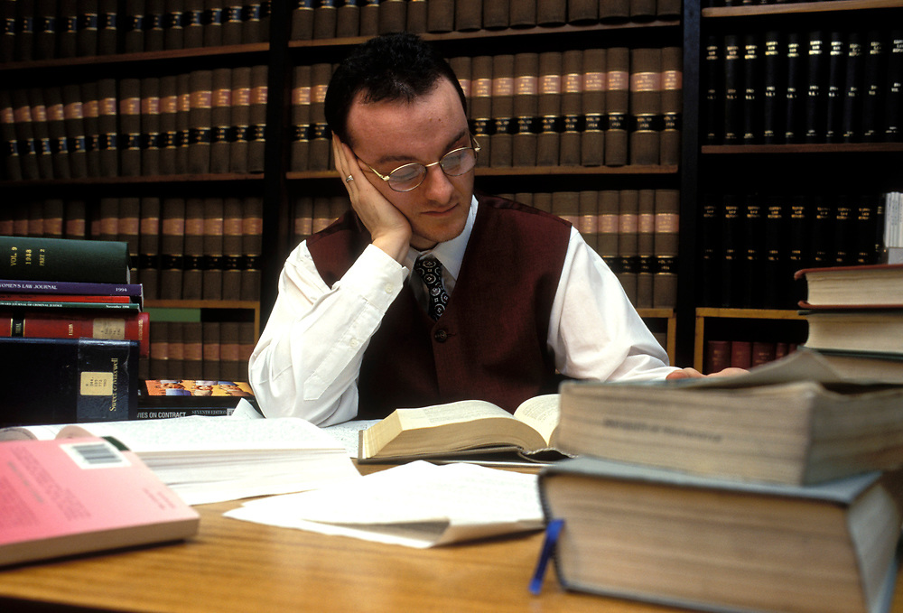 Student studying in law library; University of Westminster; London UK