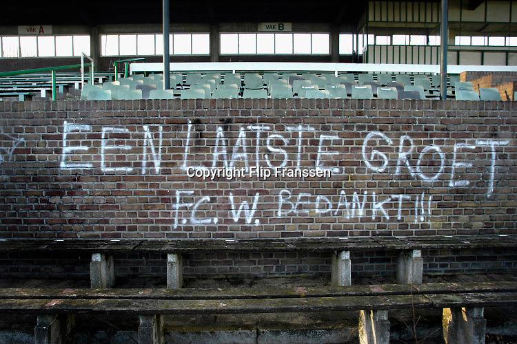 Nederland, Wageningen, 13-1-2005  Het voormalige stadion van de legendarische voetbalclub FC Wageningen, ooit een trotse erediviesie club . Vervallen maar niet gesloopt, afgebroken, vanwege de ligging in een beschermd natuurgebied, de Wageningse Berg .