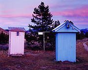 Powder pink and baby blue outhouses for ladies and gents, Big Hole River, Montana.