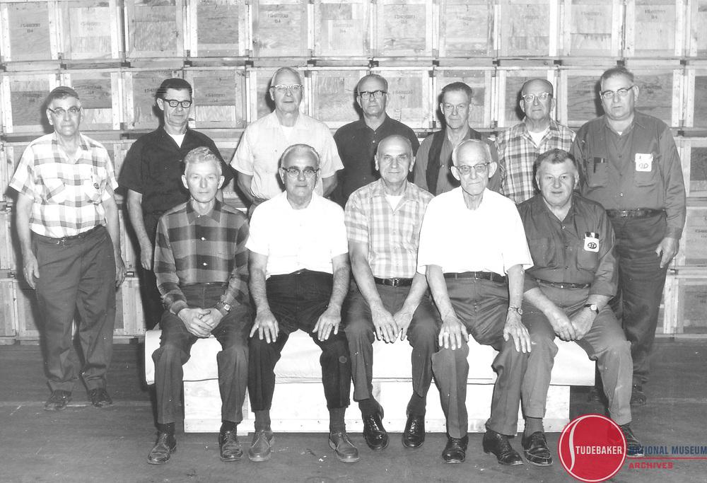 The last dozen Studebaker hourly employees, Nov. 9, 1971. Standing (L to R): N. Borsodi, J. Szlanfucht, J.Szabo, K. Anderson, E. Henry, H. Nowlcki, J. Borsodi.  Seated (L to R): C. Kulesia, J. Fuzy, C. Nowicki,<br /> W. Holewinski, F. Zielinski.