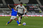 Nathan Byrne of Derby County (12) is tackled by Cardiff City forward Sheyi Ojo (27)  during the EFL Sky Bet Championship match between Derby County and Cardiff City at the Pride Park, Derby, England on 28 October 2020.
