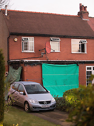 © Licensed to London News Pictures . 10/12/2013 . Bolton , UK . View of the back of the house . The scene outside 123 Albert Road West in Bolton today (10th December 2013) where three people died following a fire , yesterday morning (9th December 2013) . Police believe the fire was started deliberatively by architect Hassan Rafie , killing himself and his wife Mahnaz . Another woman staying in the house at the time , believed to be Mrs Rafie's mother , later died of injuries sustained in the fire , in hospital . Photo credit : Joel Goodman/LNP
