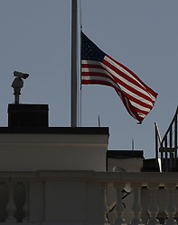 """The U.S. flag is lowered to half-staff at the White House on July 3, 2018 after President Donald Trump ordered it as """"a mark of solemn respect"""" for the four journalists and a newspaper sales representative killed last week at the Capital Gazette newsroom in Annapolis, Md .Photo by Olivier Douliery/ Abaca Press"""