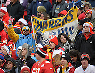 KANSAS CITY, MO - NOVEMBER 24:  A San Diego Chargers fan celebrates the Chargers 41-38 win over the Kansas City Chiefs on November 24, 2013 at Arrowhead Stadium in Kansas City, Missouri.  San Diego won 41-38. (Photo by Peter Aiken/Getty Images) *** Local Caption ***