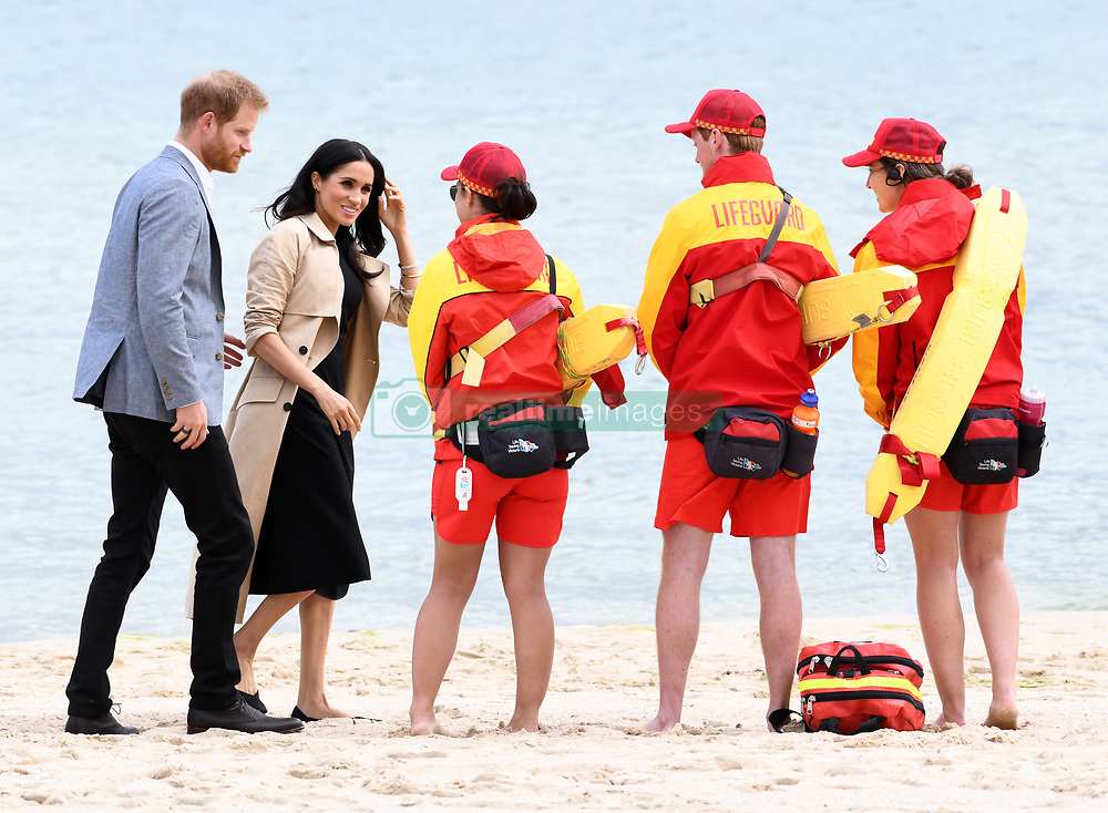 Prince Harry Duke of Sussex and Meghan Duchess of Sussex visit South Melbourne Beach, Australia to watch BeachPatrol volunteers in action and meet local lifeguards and school children. Photo credit should read: Doug Peters/EMPICS