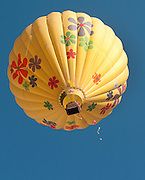 """""""Mountain Breeze""""  pops a small balloon during a contest at the Snowmass Balloon Festival, Sept. 18-20, 2009"""