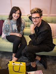 © Licensed to London News Pictures . 10/10/2013 .Manchester , UK . Model Daisy Lowe with fashion designer Henry Holland inside Selfridges . Vogue Fashions Night Out in Selfridges , Exchange Square , Manchester City Centre . Photo credit : Joel Goodman/LNP