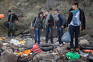 A group of Afghan asylum seekers stand on a beach near Molyvos, Lesvos island in Greece after making the journey from Turkey on a dinghy.
