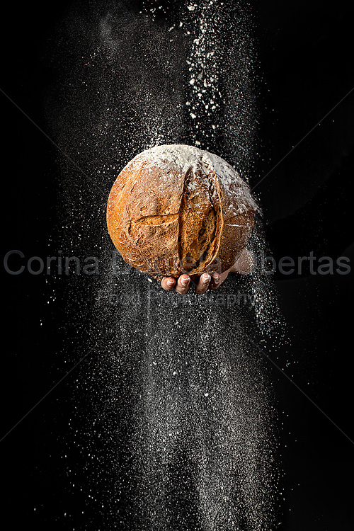 """It is a work created in February 2020 whose main theme is bread as a symbol and essential element for human life, as an image of the need for nourishment. I was inspired by the 13 verses of the Bible about bread and the words of Jesus when he speaks to man with easily understandable images. """"I am the living bread that came down from heaven. If anyone eats of this bread, he will live forever. And this bread, which I will give for the life of the world, is My flesh.""""<br /> Bread has a symbolic value and accompanies man from birth to death, throughout his life. Making bread is a form of expression and communication, of awareness and can be a huge source of stress relief.<br /> The conception period of this shot coincides with the beginning of the Covid-19 pandemic in Italy and the shot takes place just before entering the first lockdown and for this reason it has an important meaning for me as artist, because it was visionary, it was like a forecast of the future. We all know that, with much more time available, many people have started experimenting with baking bread. A global pandemic combined with economic problems and the loss of many jobs has caused a lot of stress and anxiety. Making bread and eating together was very comforting and calmed people's anxiety.<br /> Now, more than a year has passed and we almost have come out of the worst of the pandemic, but bread continues to be the essence of life and we must never forget it because, even today, bread is missing from the table of so many people who live in absolute poverty, and this contrasts with the consumerist mentality of our world, which wastes and throws so much bread!"""