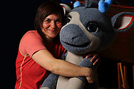 Heidi Sara, children's television host on state broadcasting's only Sami station, cuddles with baby reindeer mascot.
