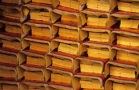 Prayer paper stacked and waiting to be burnt as offerings for ancestors at a Temple in Taiwan's capital Taipei.