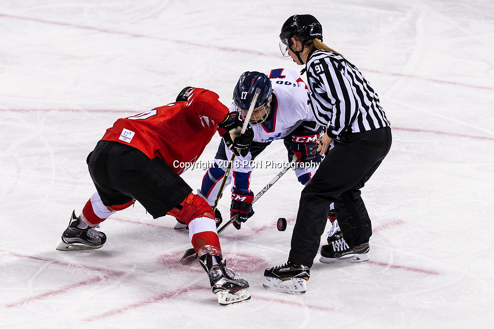 Face off between Dominique Ruegg (SUI) #26 and  Soojin Han (KOR) #17 during Korea (combinded) vs Switzerland Women's Ice Hockey competition at the Olympic Winter Games PyeongChang 2018