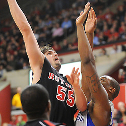Rutgers Scarlet Knights forward Gilvydas Biruta (55) hooks a basket over Seton Hall Pirates forward Herb Pope (15) during second half Big East NCAA Basketball between the Rutgers Scarlet Knights and Seton Hall Pirates at the Louis Brown Athletic Center. Seton Hall defeated Rutgers 59-55.