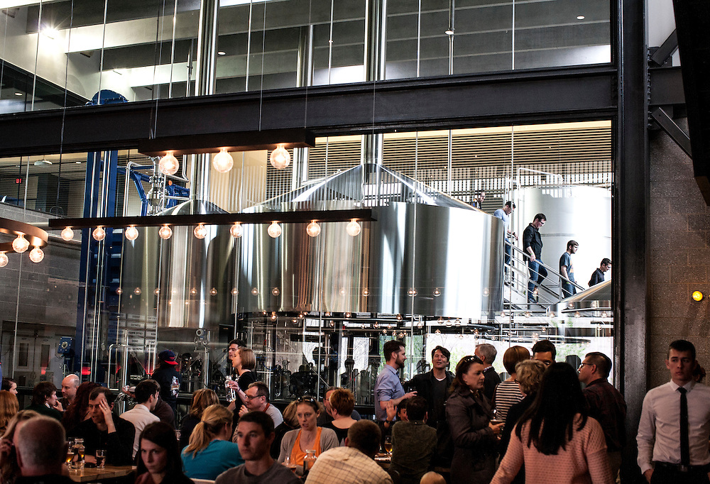 A glass wall separates the brewing area (open to tours) from the beer hall at Surly Brewing Co. in Minneapolis, MN, May 15, 2015.
