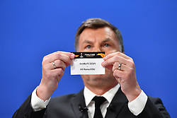 NYON, SWITZERLAND - Friday, July 10, 2020: Former Bayern Munich player Thomas Helmer draws out the card for Sevilla and AS Roma during the UEFA Champions League and UEFA Europa League 2019/20 draws for the Quarter-final, Semi-final and Final at the UEFA headquarters, The House of European Football. (Photo Handout/UEFA)