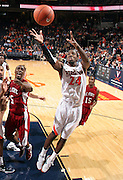 CHARLOTTESVILLE, VA- NOVEMBER 13: K.T. Harrell #24 of the Virginia Cavaliers looks for the rebound during the game on November 13, 2011 at the John Paul Jones Arena in Charlottesville, Virginia. Virginia defeated South Carolina State 75-38. (Photo by Andrew Shurtleff/Getty Images) *** Local Caption *** K.T. Harrell