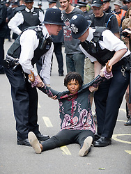 © licensed to London News Pictures.  30/06/2011. London, UK. A woman being detained by police officers. Public sector workers and Union members demonstrate in London today (30/06/2011) against planned changes to pension plans and funding cuts. Marches are taking place across the UK.  See special instructions. Photo credit: Ben Cawthra/LNP