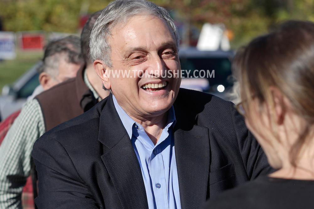 Middletown, New York - Republican gubernatorial candidate Carl Paladino greets a supporter before forum hosted by the Orange/Sullivan County 912 Tea Party in the parking lot outside party headquarters on Oct. 9, 2010.