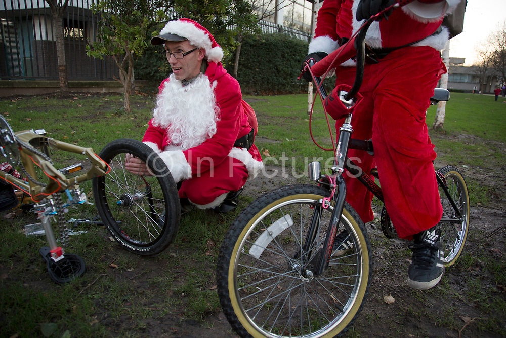 Members of Old School BMX Life on the Santa Cruise charity day out at the Undercroft, South Bank, London, UK. All dressed up wearing Santa Claus outfits and sporting fine white beards, while riding their beloved BMXs. A fun gathering for friends and enthusiasts.