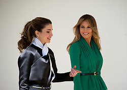 Queen Rania of Jordan, left, and first lady Melania Trump, right, walk along the Colonnade of the White House in Washington, DC on Wednesday, April 5, 2017. (Photo by Ron Sachs/Pool/CNP) *** Please Use Credit from Credit Field ***
