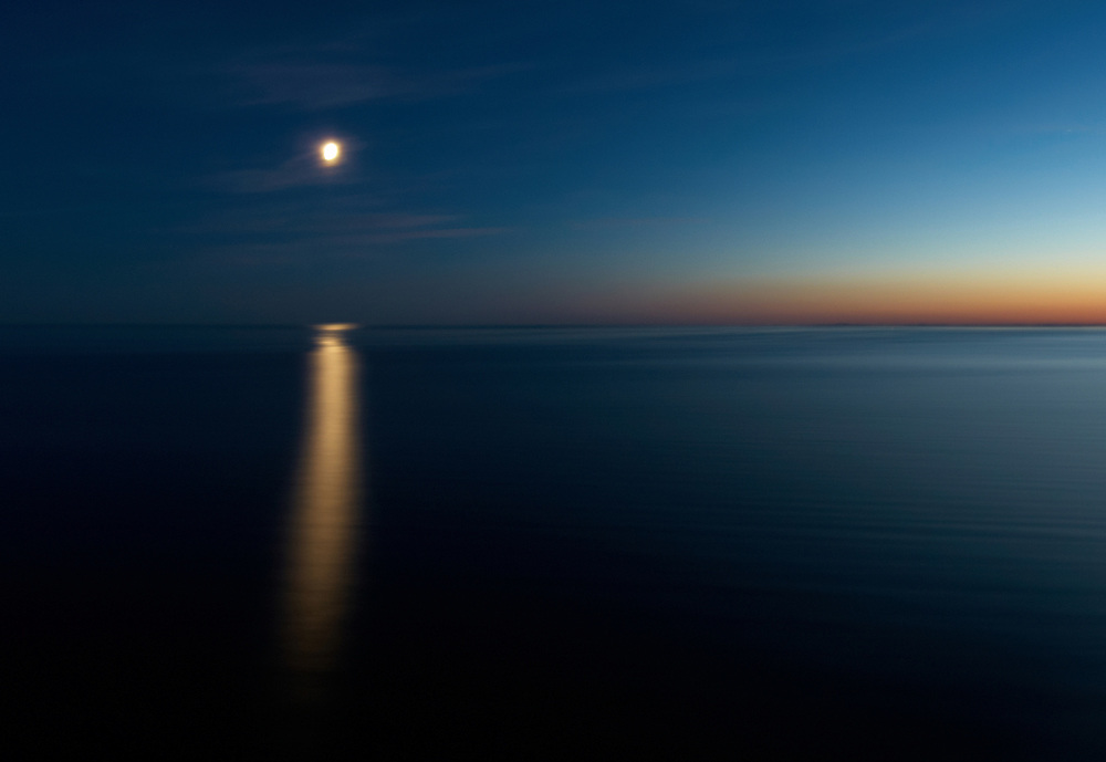Norway - Moon and sunset on sea