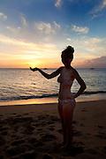 Girl holding sun, Sunset, Kaanapali Beach, Maui, Hawaii
