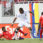 USA forward Juan Agudelo (9) dribbles past Panama midfielder Armando Cooper (11) and Panama defender  Eduardo Dasent (14) during a  CONCACAF Gold Cup soccer match between the United States and Panama on Saturday, June 11, 2011, at Raymond James Stadium in Tampa, Fla. (AP Photo/Alex Menendez)