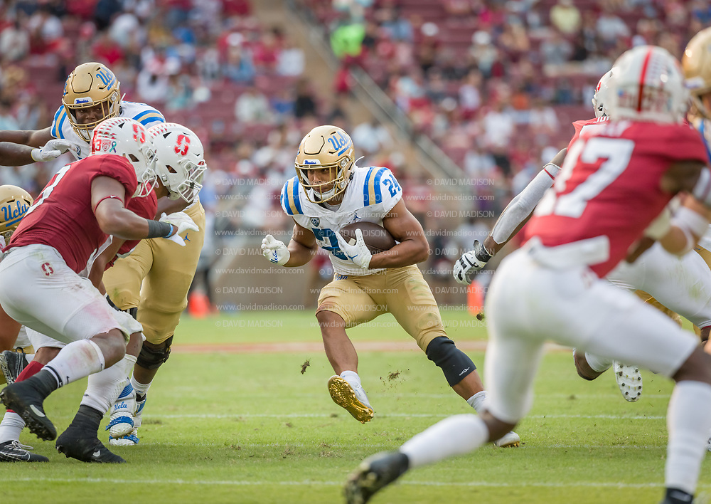 PALO ALTO, CA - SEPTEMBER 26:  Zach Charbonnet #24 of the UCLA Bruins carries the ball during an NCAA Pac-12 college football game against the Stanford Cardinal on September 26, 2021 at Stanford Stadium in Palo Alto, California.  (Photo by David Madison/Getty Images)