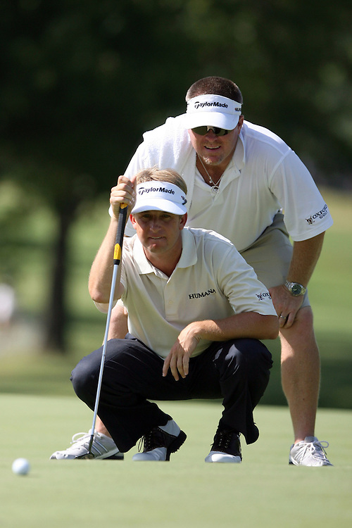 09 August 2007: David Toms and caddie Scott Gneiser analyze the 9th green during the first round of the 89th PGA Championship at Southern Hills Country Club in Tulsa, OK.