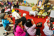09 OCTOBER 2014 - BANGKOK, THAILAND: People use their smart phones to take pictures of the King's portrait after praying for Bhumibol Adulyadej, the King of Thailand in the lobby of Siriraj Hospital. The King has been hospitalized at Siriraj Hospital since Oct. 4 and underwent emergency gall bladder removal surgery Oct. 5. The King is also known as Rama IX, because he is the ninth monarch of the Chakri Dynasty. He has reigned since June 9, 1946 and is the world's longest-serving current head of state and the longest-reigning monarch in Thai history, serving for more than 68 years. He is revered by the Thai people and anytime he goes into the hospital thousands of people come to the hospital to sign get well cards.   PHOTO BY JACK KURTZ