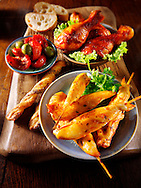 Party buffet food with chicken satay and BBQ drum sticks