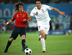 Carles Puyol of Spain (5) vs Luca Toni of Italy (9) during the UEFA EURO 2008 Quarter-Final soccer match between Spain and Italy at Ernst-Happel Stadium, on June 22,2008, in Wien, Austria. Spain won after penalty shots 4:2. (Photo by Vid Ponikvar / Sportal Images)