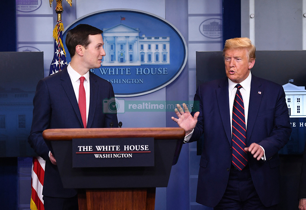 President Donald Trump, right, speaks to his son-in-law Jared Kushner at a Coronavirus briefing at the White House on Thursday, April 2, 2020 in Washington, DC. Due to the COVID-19 pandemic, at least 5,700 people have died in the United States with more than 200,000 infected. More than 10 million people have lost their jobs in the U.S. in the past two weeks. Photo Kevin Dietsch/Pool/ABACAPRESS.COM
