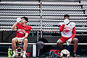 ORADELL, NJ - September 17: Bergen Catholic players practice hard and also practice social distancing when they are not on the field. George Christodoulou and Larue Linder social distance during a water break at practice.<br /> <br /> We are in the midst of witnessing something this world hasn't seen - a global pandemic. The coronavirus has swept away the world and the United States in March of 2020 - since then, the world we know It hasn't been the same. Jobs, businesses and futures have been put on hold and lost, yet we have to power through to overcome one of the greatest obstacles this world has faced. The high school football season wasn't suppose to happen but a glimmer of hope, intense safety measures & a little bit of luck has allowed for the season to start, now the question is ' Can It be completed?'<br /> <br /> Photo by Johnnie Izquierdo